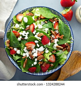 Fresh strawberries, spinach and goat cheese salad