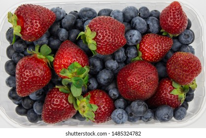 Fresh strawberries. Strawberry background. Macro texture. big, big strawberries. Fresh strawberry and blueberries. summer composition.