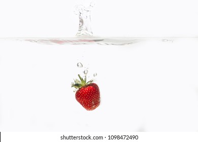 Fresh Strawberries with water splash over white background. Red berry strawberry isolated on white background. Space for text