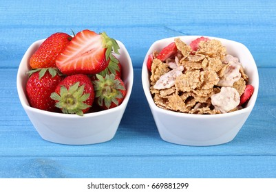 Fresh strawberries, wheat and rye flakes in glass bowl on boards, concept of healthy lifestyle and nutrition