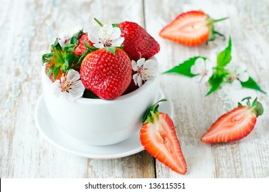 Fresh strawberries in the white bowl, selective focus