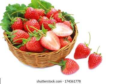 Fresh strawberry in basket wicker on white background.