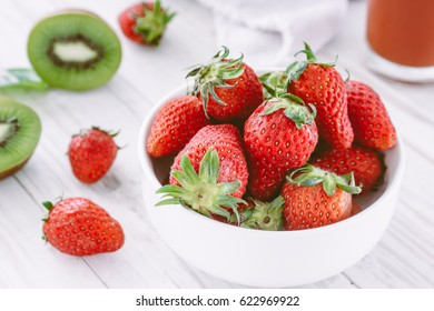 Fresh Strawberry in a bow on wooden table