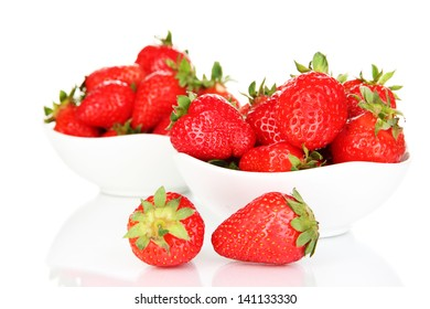 Fresh strawberry in bowl isolated on white