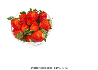 Fresh strawberry in a bowl on a white background, isolated top view. Copy space for text. Summer health concept