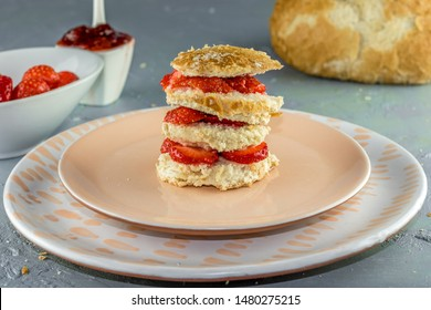 Fresh Strawberry breakfast bun on soft pink plate
