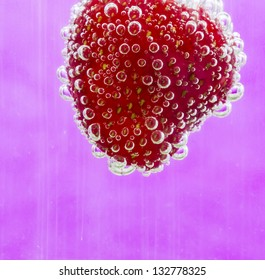 Fresh strawberry in bubbly water/Bubbly strawberry/Abstract fruit