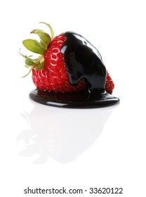 Fresh strawberry covered in dark chocolate