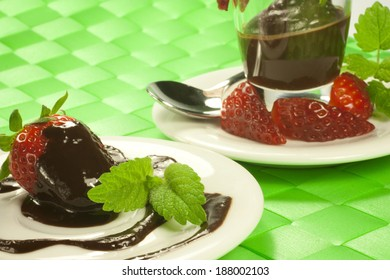 fresh strawberry covered in melted chocolate