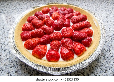 Fresh strawberry cream cheese pie from above on kitchen counter