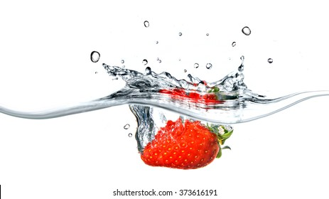 Fresh strawberry dropped into blue water with splash isolated on white. Header for website