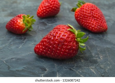 Fresh strawberry fruit on dark background