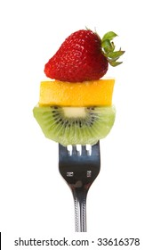 Fresh strawberry, mango slice, and kiwi on a fork