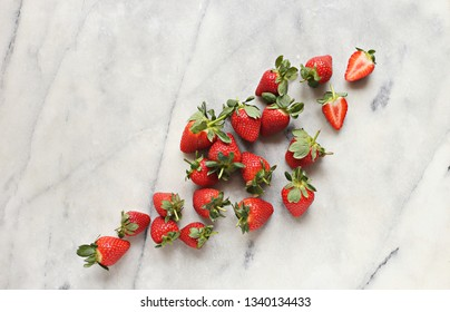 Fresh strawberry on marble table. Flat lay, copy space