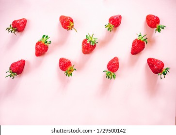 Fresh strawberry pattern on the light pink background. View from above.