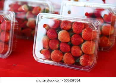 Fresh strawberry in plastic box of packaging for sale.