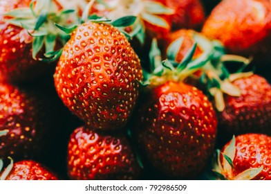 Fresh strawberry in plate on rustic wooden table
