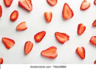 Fresh strawberry slices on white background