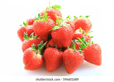 Fresh strawberry, sweet fruits, on the white plastic chopping board, as background or print card.