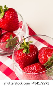 Fresh strawberry in transparent cups.