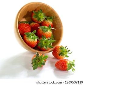Fresh strawberry in the wooden chalice on white background / Select focus and space for texts