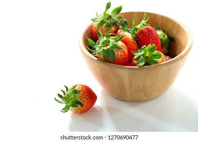 Fresh strawberry in the wooden chalice on white background / Select focus and space for texs, messages