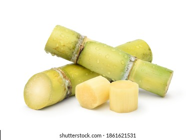 Fresh sugar cane with water droplets and sliced isolated on white background.