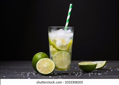 fresh summer alcohol caipirinha on a stone table. party beverage cocktail background