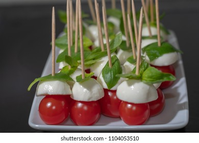 Fresh summer Apero snack with fresh tomato and mozzarella on plate