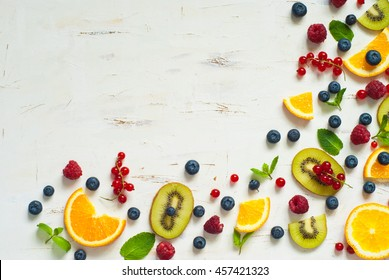 Fresh summer berries and fruits on white  background. Healthy food concept. Flat lay. Fruit background with copy space.