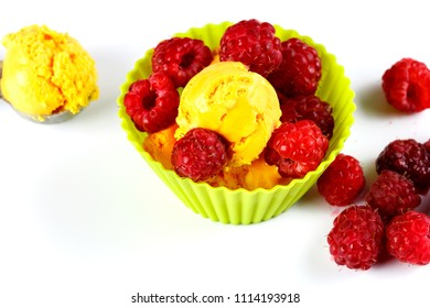 Fresh summer ice cream with cantaloupe melon flavour and raspberry fruits on a colourful and white set