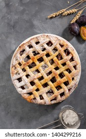 Fresh summer pie with plums, food above