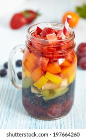 Fresh Summer Rainbow Sangria with Colorful Fruits And Berries