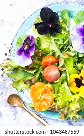Fresh summer salad with edible flowers and herbs.Healthy food.Detox.