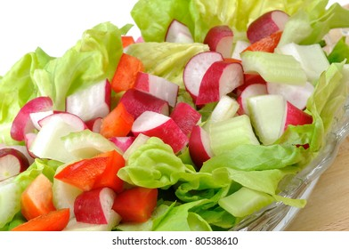 fresh summer salad with radishes, lettuce, celery and peppers
