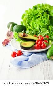 Fresh summer vegetables on white wooden background, selective focus
