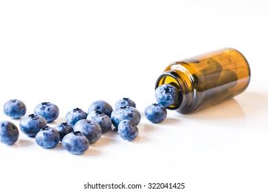 Fresh sweet blueberry fruit  in medical bottle from pills. Dessert healthy food. Group of ripe blue juicy organic berries. Raw summer diet. Delicious nature vegetarian ingredient