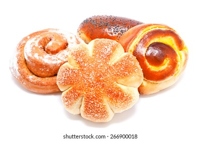 Fresh sweet buns and rolls with poppy and cream isolated on a white