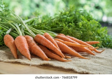 Fresh and sweet carrot on wooden table, Healthy food.