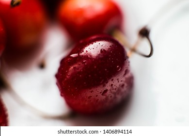 Fresh sweet cherry with water droplets