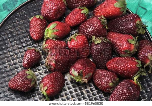 Fresh, sweet, delicious strawberries closeup. The view from the top