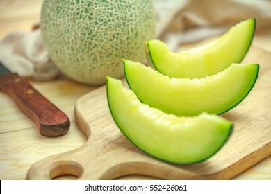 Fresh sweet green melon on the wooden table