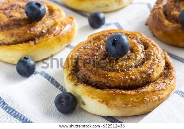 Fresh Sweet Homemade Cinnamon Rolls with blueberries