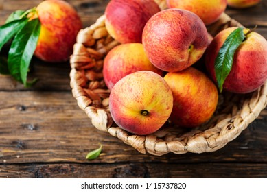 Fresh sweet peaches on the wooden table, selective focus