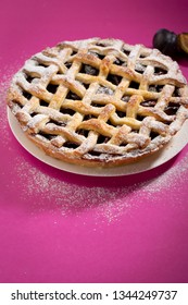 Fresh sweet pie on pink background