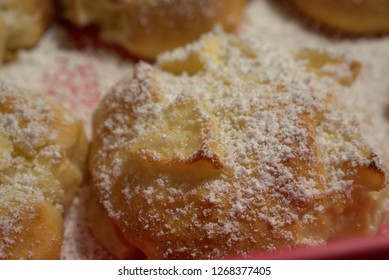 fresh sweet pieces with apples and icing sugar