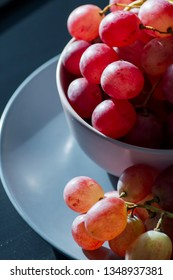 Fresh and sweet red grapes on a blue plate