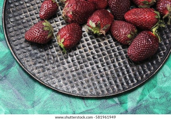 Fresh, sweet, tasty, useful, delicious strawberries closeup. The view from the top