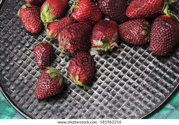 Fresh, sweet, tasty, useful, delicious, juicy strawberries closeup. The view from the top