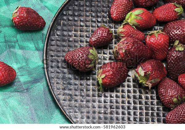 Fresh, sweet, tasty, useful, delicious, juicy strawberries closeup. The view from the top. Proper nutrition